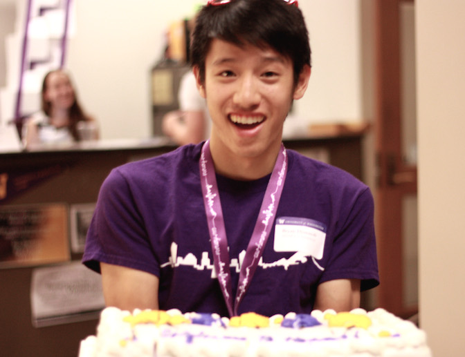 Bryan Djunaedi with cake at the Honors Open House