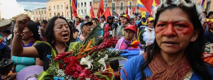 Image: indigenous feminist activists protest at a rally in Ecuador in 2015