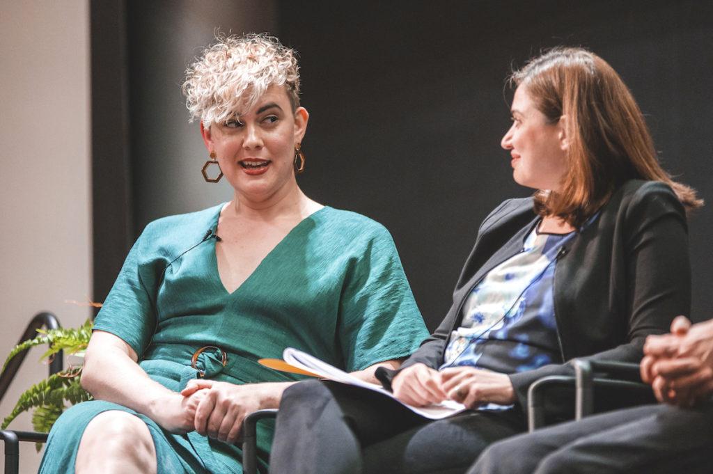 Anna Lauren Hoffman quriks an eyebrow while responding, Ece Kamar smiles at her response