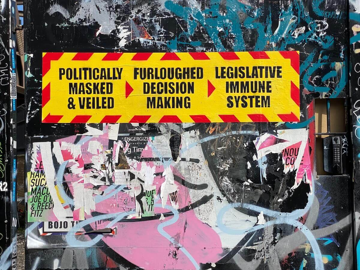 Street art in Times Square demonstrates mistrust of government motives and processes