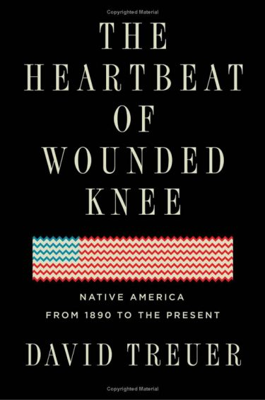 "Black book cover with a graphic of abstract/hand stitched fabric belt resembling the American flag. Text reads: ""The Heartbeat of Wounded Knee, Native America from 1890 to the present"" The author's name is ""David Treuer"""