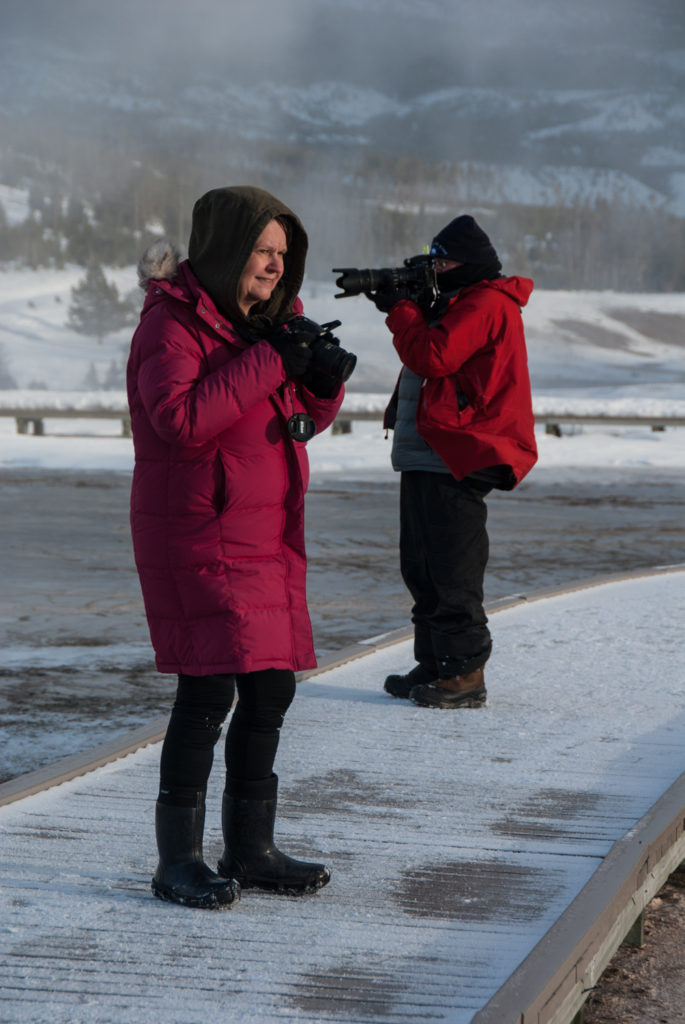 Sue Sherbrooke taking photos on a snowy trip to Yellowstone
